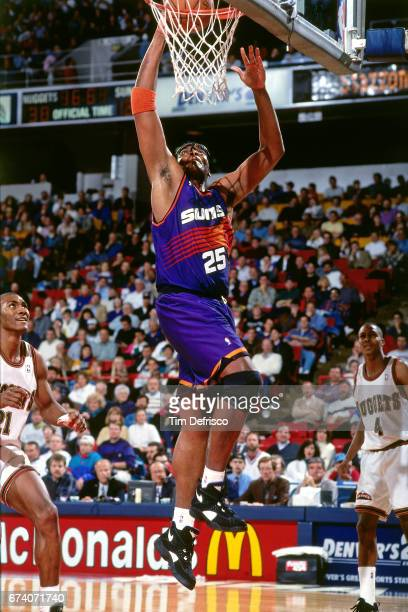 Oliver Miller of the Phoenix Suns shoots against the Denver Nuggets circa 1994 at the McNichols Sports Arena in Denver Colorado NOTE TO USER User...