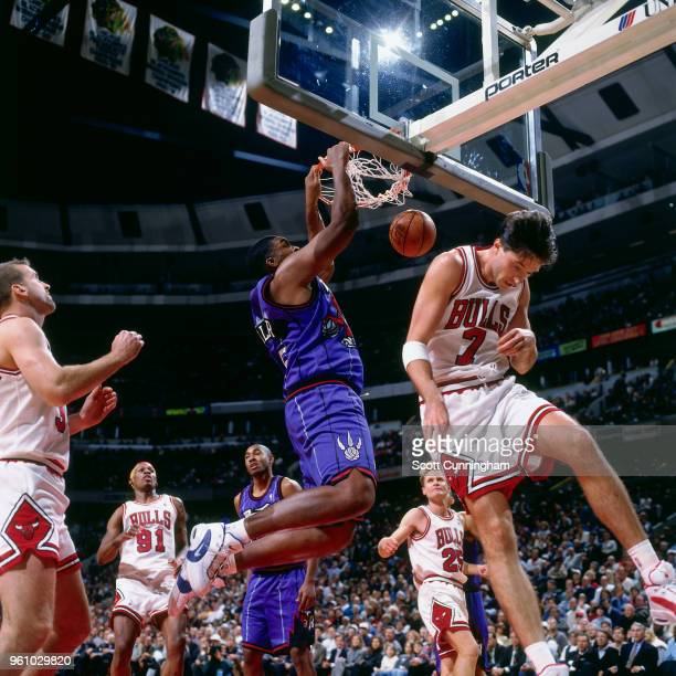 Oliver Miller of the Toronto Raptors dunks the ball against the Chicago Bulls on November 7 1995 at the United Center in Chicago Illinois NOTE TO...