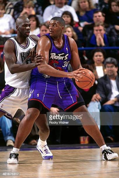 Oliver Miller of the Toronto Raptors posts up during a game played on January 30 1996 at Arco Arena in Sacramento California NOTE TO USER User...