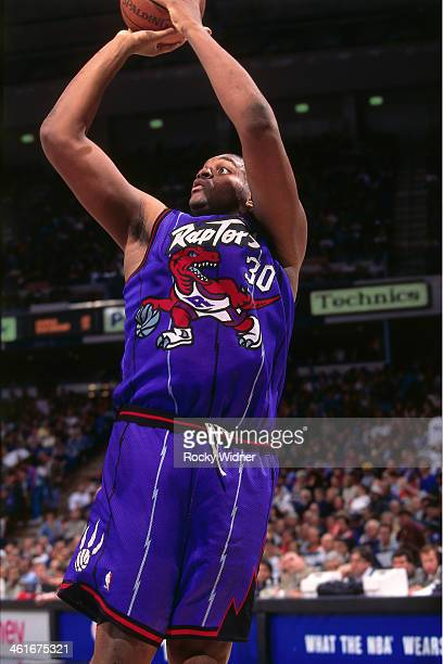 Oliver Miller of the Toronto Raptors shoots the ball during a game played on January 30 1996 at Arco Arena in Sacramento California NOTE TO USER User...