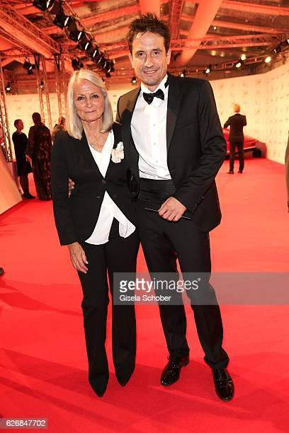 Oliver Mommsen and his mother Claudia Mommsen during the Bambi Awards 2016 arrivals at Stage Theater on November 17 2016 in Berlin Germany