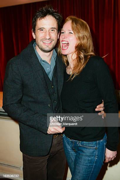 Oliver Mommsen and his wife Nicola Mommsen during the Premiere of 'Eine ganz normale Familie' at the Theater am Kurfuerstendamm on March 11 2013 in...