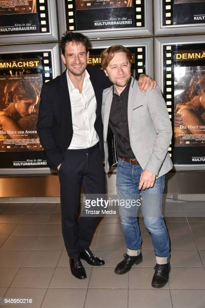Oliver Mommsen and producer Adrian Topol during the premiere 'Die Haut der Anderen' at Kino in der Kulturbrauerei on April 13, 2018 in Berlin,...