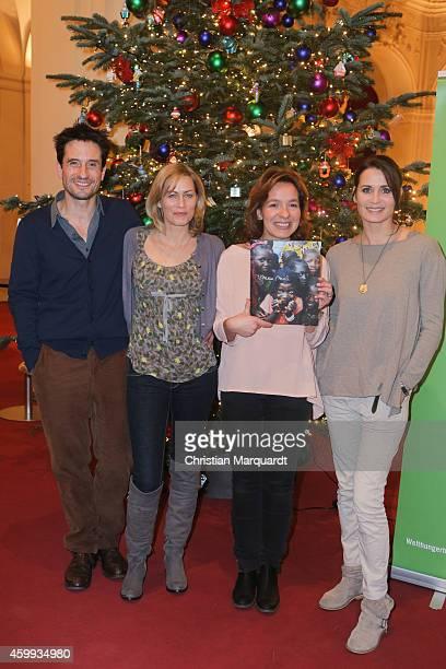 Oliver Mommsen Gesine Cukrowski Mirjam Knickriem and Anja Kling attend the 'Mein Mali' Book Presentation at Komische Oper on December 4 2014 in Berlin