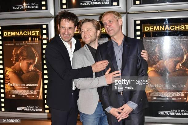 Oliver Mommsen producer Adrian Topol and director Thomas Stiller during the premiere 'Die Haut der Anderen' at Kino in der Kulturbrauerei on April 13...