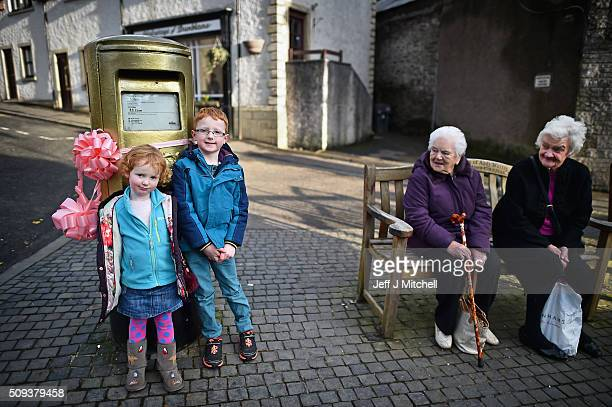 Oliver Mullen aged six and his sister Hannah aged three stand next to the Olympic post box in Andy Murray's hometown of Dunblane where things have...