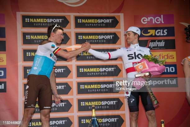 Oliver Naesen of AG2R La Mondiale second and Michal Kwiatkowski of Team Sky third are seen on the podium during the 110th edition of Milan Sanremo...