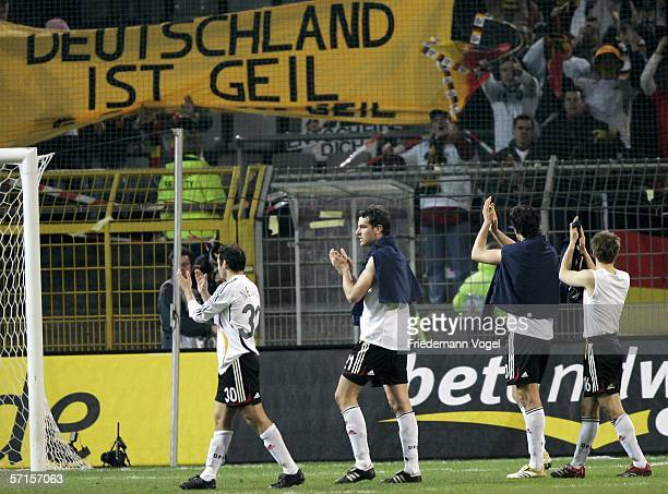 Oliver Neuville Christoph Metzelder Michael Ballack and Philipp Lahm of Germany celebrates after the winning international friendly match between...