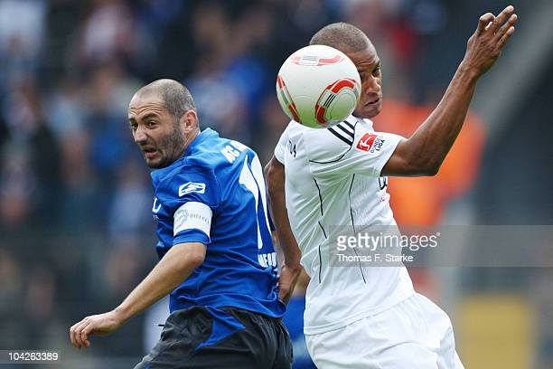 Oliver Neuville of Bielefeld and David Pisot of Ingolstadt head for the ball during the Second Bundesliga match between Arminia Bielefeld and FC...