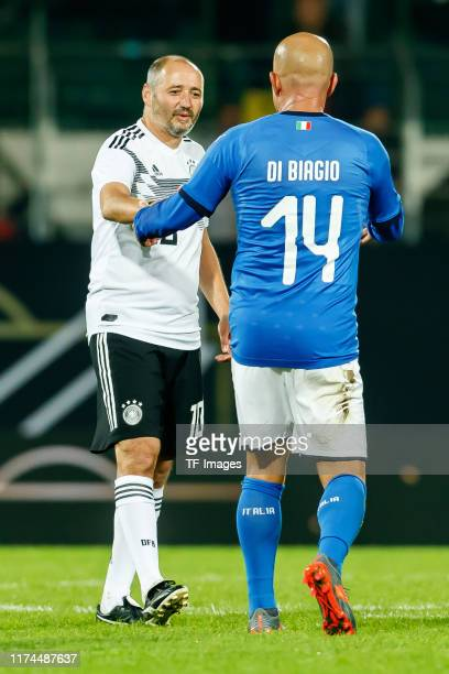 Oliver Neuville of Germany Luigi Di Biagio of Italy after the game during the friendly match between DFBAllStars and Azzurri Legends at Sportpark...