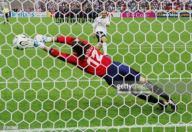 Oliver Neuville of Germany scores a penalty past Leonardo Franco of Argentina in a penalty shootout during the FIFA World Cup Germany 2006...