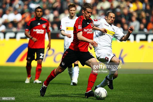 Oliver Neuville of Gladbach and Lars Bender of Leverkusen battle for the ball during the Bundesliga match between Borussia Moenchengladbach and Bayer...