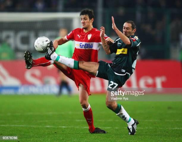 Oliver Neuville of Gladbach and Zdravko Kuzmanovic of Stuttgart battle for the ball during the Bundesliga match between Borussia Moenchengladbach and...
