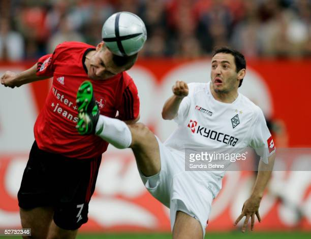 Oliver Neuville of Moenchengladbach challenges Marek Nikl of Nuremberg during the Bundesliga match between 1.FC Nuremberg and Borussia...
