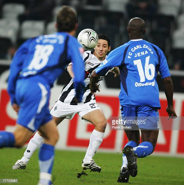 Oliver Neuville of Moenchengladbach fights for the ball against Darlington Omodiagbe of Jena and Michael Stegmayer during the Second Bundesliga match...