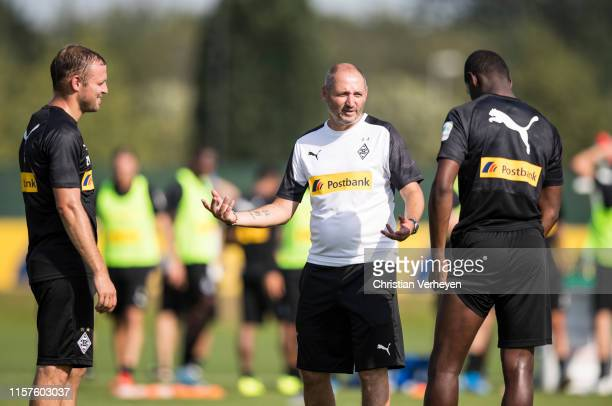 Oliver Neuville talks to Mamadou Doucoure and Tony Jantschke during a Training session of Borussia Moenchengladbach at BorussiaPark on July 24 2019...