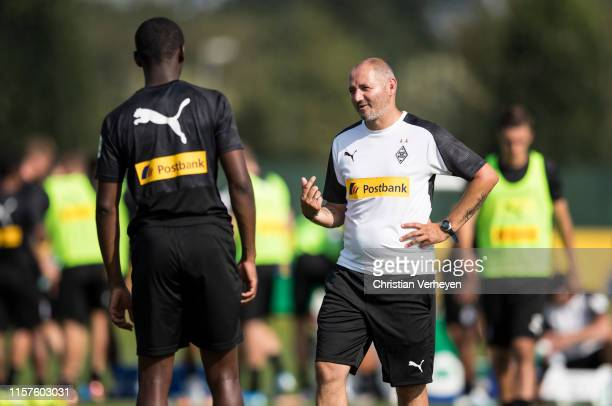 Oliver Neuville talks to Mamadou Doucoure during a Training session of Borussia Moenchengladbach at BorussiaPark on July 24 2019 in Moenchengladbach...