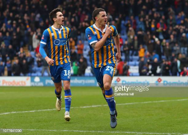 Oliver Norburn celebrates with Alex Gilliead of Shrewsbury Town after scoring his team's first goal during the FA Cup Third Round match between...