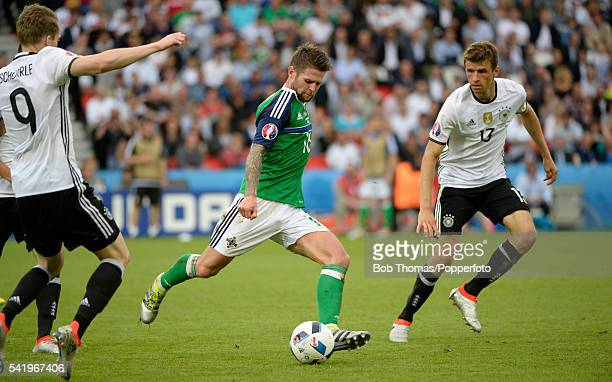 Oliver Norwood in action for Northern Ireland during the UEFA EURO 2016 Group C match between Northern Ireland and Germany at Parc des Princes on...