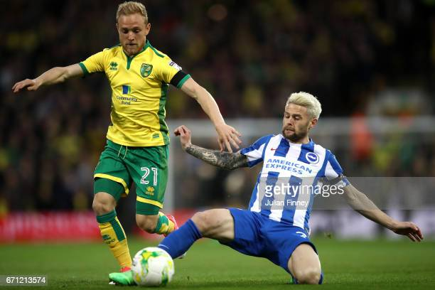 Oliver Norwood of Brighton and Alex Pritchard of Norwich City in action during the Sky Bet Championship match between Norwich City and Brighton &...