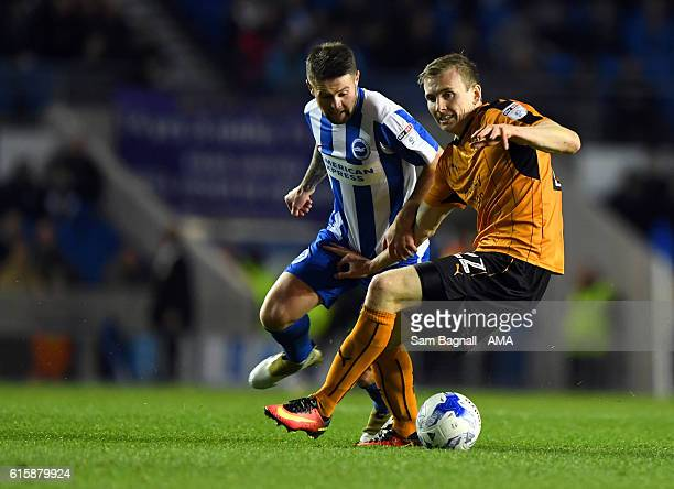 Oliver Norwood of Brighton and Hove Albion and Jon Dadi Bodvarsson of Wolverhampton Wanderers during the Sky Bet Championship match between Brighton...