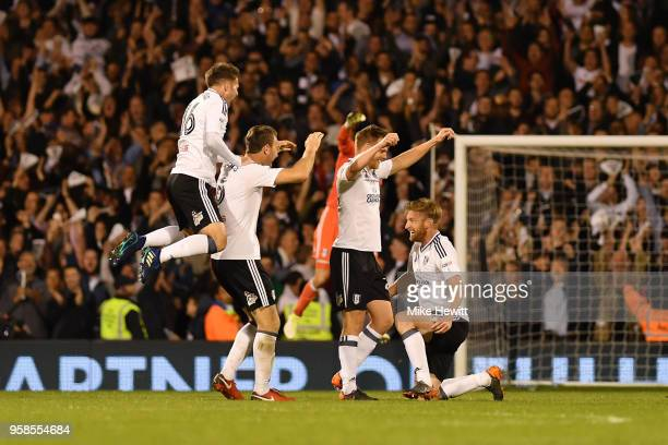 Oliver Norwood of Fulham and Ryan Sessegnon of Fulham celebrates with team mates at the final whistle during the Sky Bet Championship Play Off Semi...