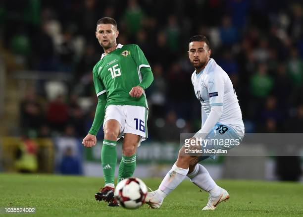 Oliver Norwood of Northern Ireland and Dia Seba of Israel during the international friendly football match between Northern Ireland and Israel at...