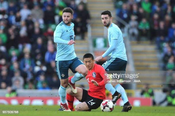 Oliver Norwood of Northern Ireland and Kim Minwoo of South Korea during an International Friendly fixture between Northern Ireland and Korea Republic...