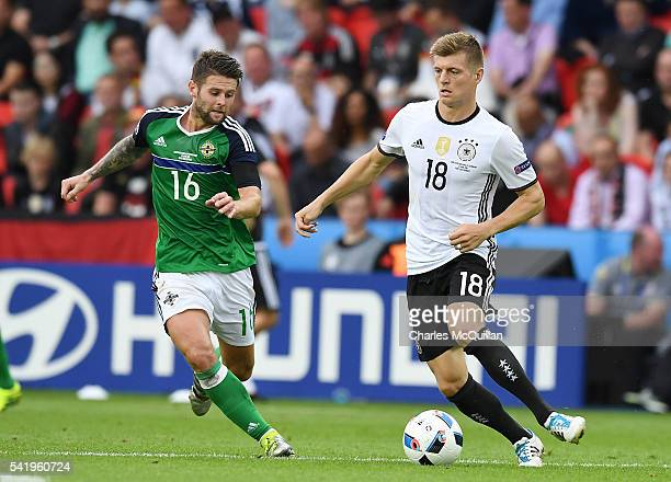 Oliver Norwood of Northern Ireland and Toni Kroos of Germany during the UEFA EURO 2016 Group C match between Northern Ireland and Germany at Parc des...