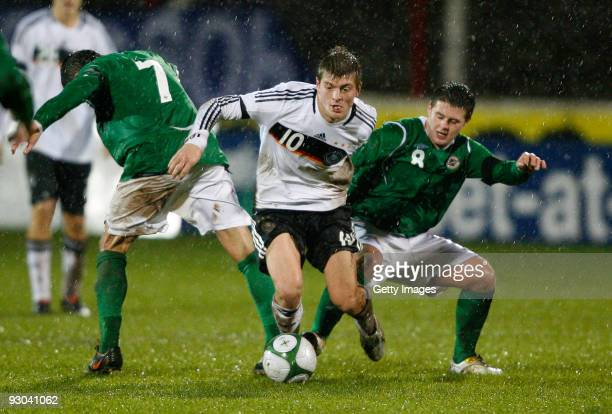 Oliver Norwood of Nothern Ireland and Toni Kroos of Germany battle for the ball during the U21 Championship Group 5 match between Nothern Ireland and...
