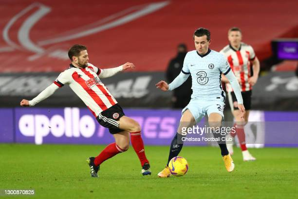 Oliver Norwood of Sheffield United stretches to challenge Ben Chilwell of Chelsea for the ball during the Premier League match between Sheffield...