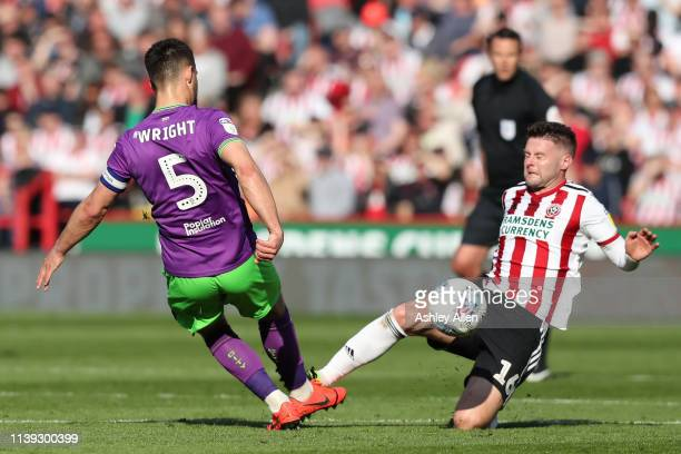 Oliver Norwood of Sheffield United tackles Bailey Wright of Bristol City during the Sky Bet Championship match between Sheffield United and Bristol...