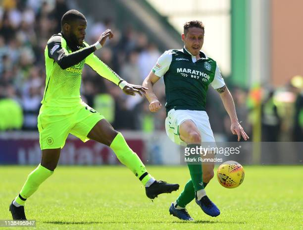 Oliver Ntcham of Celtic challenges Mark Milligan of Hibernian for the ball during the Ladbrokes Premiership match between Hibernian and Celtic at...
