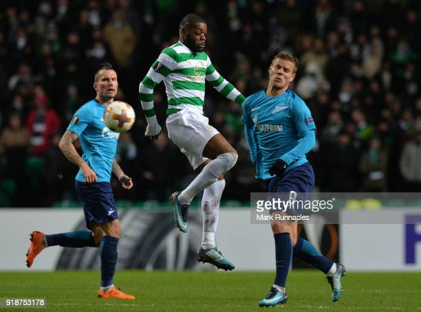 Oliver Ntcham of Celtic take the ball ahead of Alexander Kokorin of Zenit St Petersburg during UEFA Europa League Round of 32 match between Celtic...