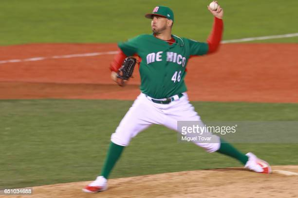 Oliver Perez of Mexico pitches in the bottom of the ninth inning during the World Baseball Classic Pool D Game 1 between Italy and Mexico at...
