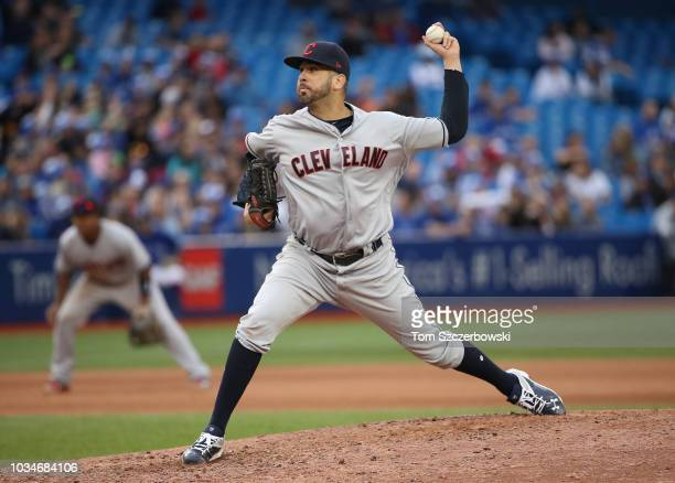 Oliver Perez of the Cleveland Indians delivers a pitch in the seventh inning during MLB game action against the Toronto Blue Jays at Rogers Centre on...