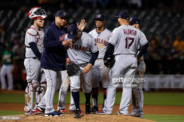 Oliver Perez of the Cleveland Indians is relieved by manager Terry Francona after facing a single batter who was intentionally walked during the...