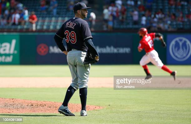 Oliver Perez of the Cleveland Indians looks on after giving up a home run to Rougned Odor of the Texas Rangers during the eighth inning at Globe Life...