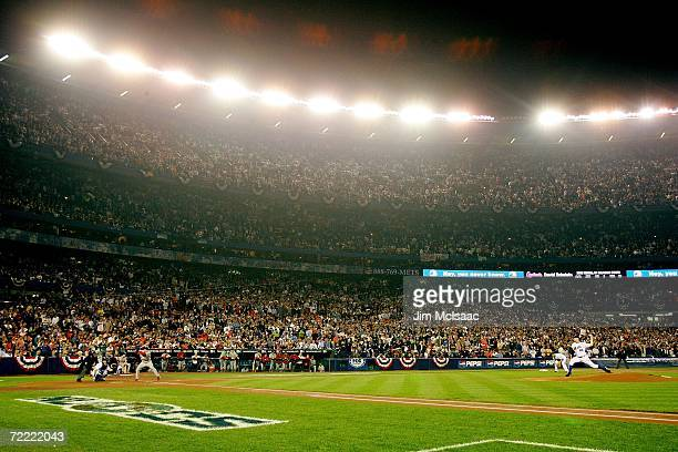 Oliver Perez of the New York Mets pitches to David Eckstein of the St Louis Cardinals during game seven of the NLCS at Shea Stadium on October 19...
