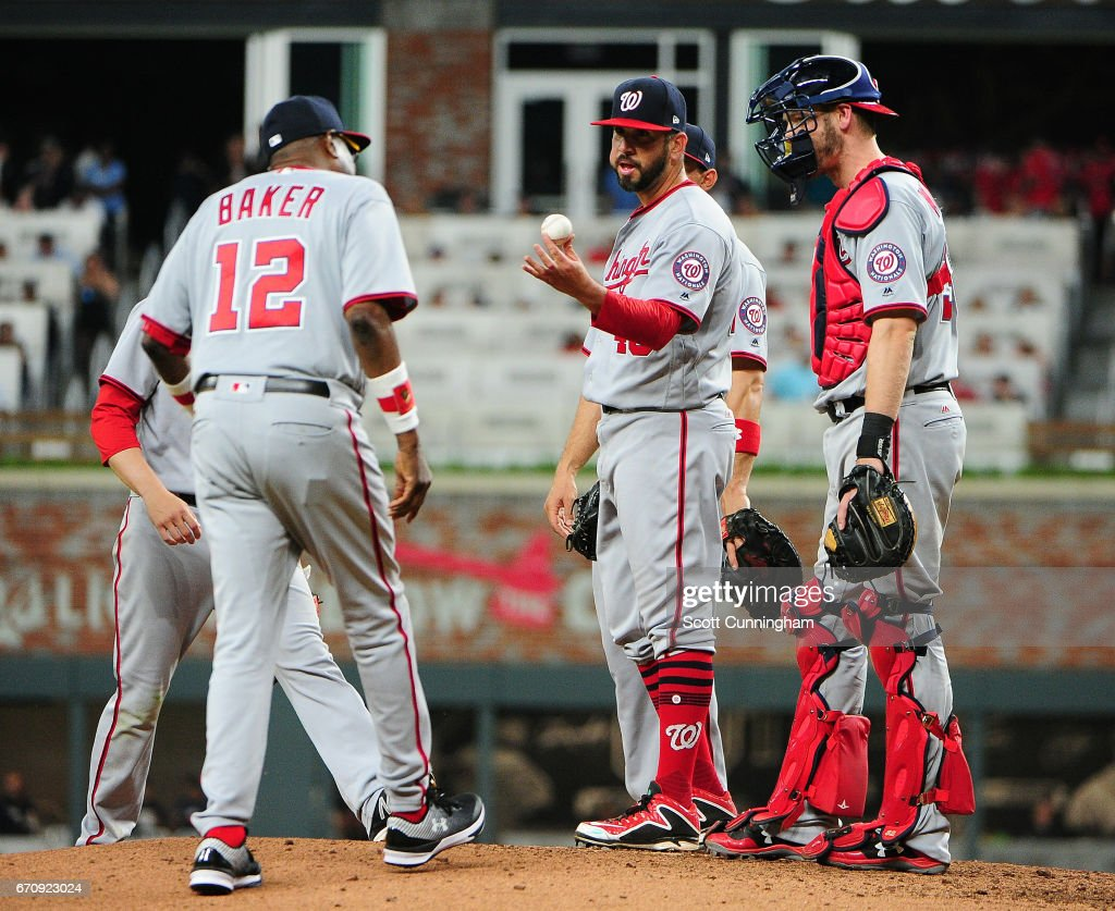 Oliver Perez #46 of the Washington Nationals is removed from the game in the eighth inning by Manager Dusty Baker #12 against the Atlanta Braves at SunTrust Park on April 20, 2017 in Atlanta, Georgia.
