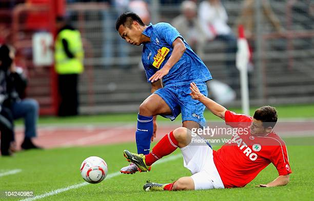 Oliver Petersch of Oberhausen and Chong Tese of Bochum battle for the ball during the Second Bundesliga match between RW Oberhausen and VfL Bochum at...