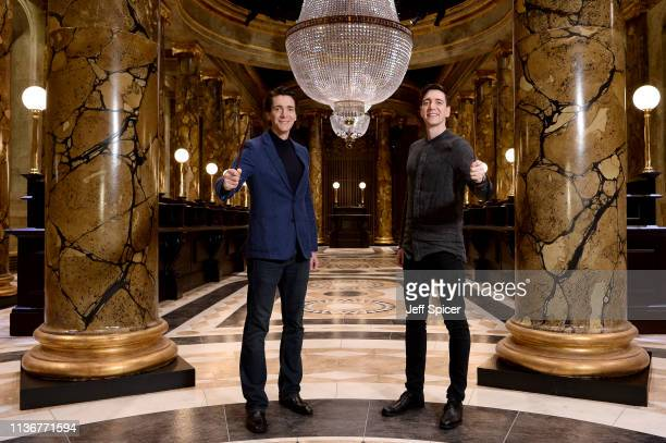 Oliver Phelps and James Phelps in the original Gringotts Wizarding Bank set at Warner Bros Studio Tour London on March 19 2019 in Watford England...