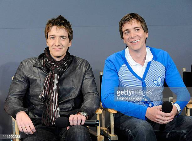 Oliver Phelps and James Phelps visits the Apple Store Soho on April 3 2011 in New York City