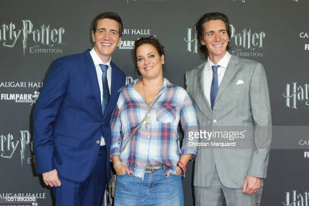 Oliver Phelps Muriel Baumeister and James Phelps attend the 'Harry Potter The Exhibition' VIP opening at Filmpark Babelsberg on October 12 2018 in...