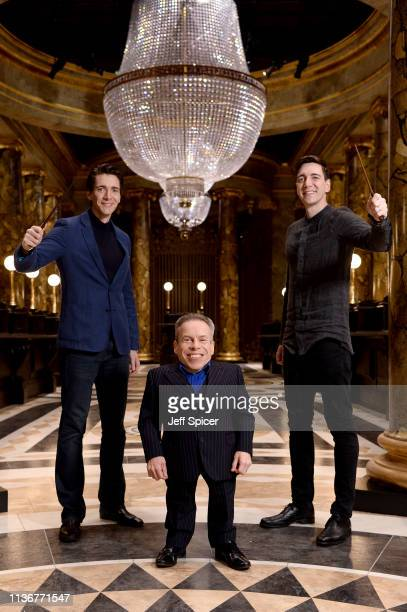 Oliver Phelps Warwick Davis and James Phelps in the original Gringotts Wizarding Bank set at Warner Bros Studio Tour London on March 19 2019 in...