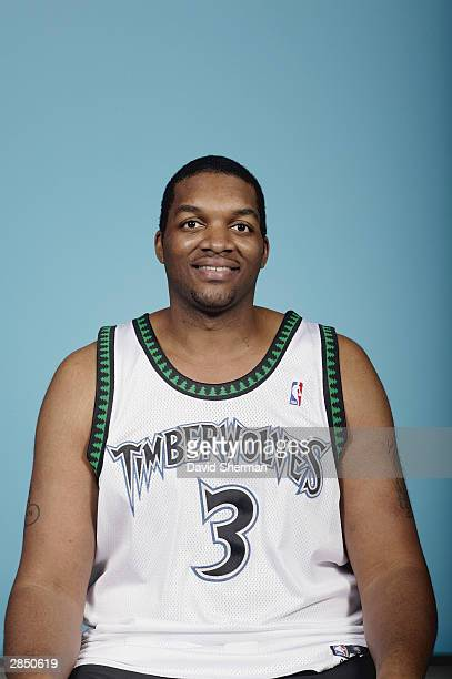 Oliver Pig Miller of the Minnesota Timberwolves poses for a picture before the start of the game against the Chicago Bulls on December 30 2003 at...