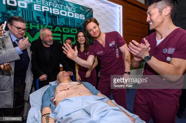 """Oliver Platt, Dick Wolf, S. Epatha Merkerson, Torrey DeVitto, Nick Gehlfuss, and Brian Tee attend the """"Chicago Med"""" 100th Episode Cake Cutting at..."""