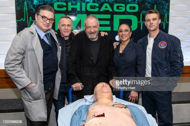 """Oliver Platt, Jason Beghe, Dick Wolf, S. Epatha Merkerson, and Jesse Spencer attend the """"Chicago Med"""" 100th Episode Cake Cutting at Cinespace on..."""