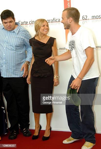 Oliver Platt Sienna Miller and Heath Ledger during 2005 Venice Film Festival Casanova Photocall at Casino Palace in Venice Lido Italy
