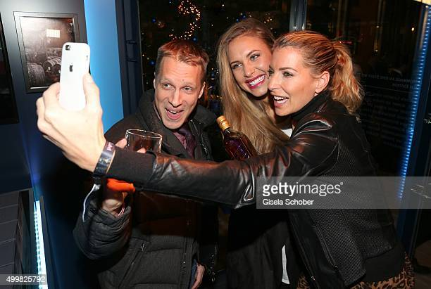 Oliver Pocher Alena Gerber and Giulia Siegel take a selfie at the opening party of the Johnnie Walker Blue Label PopUp area at Brenner on December 3...